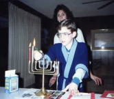 My youngest stepson and me, lighting the Hanukkah candles. We celebrate both holidays at our house as I was raised Jewish and they  always had Christmas. The boys liked lighting the candles. - Dana W