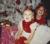 Here is a picture of my sister and I Christmas morning 51 years ago.    We are 9 years apart in age but as close as two sisters can be. - Terri A