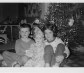 Christmas 1959 That's me in the center with my brother, Kent, and sister, Karen. Gotta love my get-up!!! - Kris Y